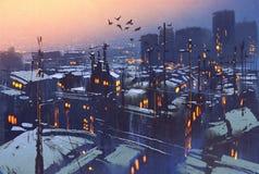 城市多雪的冬天场面,用雪盖的屋顶在日落 库存照片