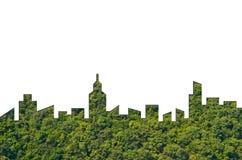 城市形状图表在森林纹理背景的 绿色大厦建筑学 库存照片