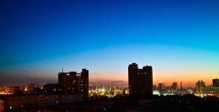 城市日落乌鲁木齐 免版税库存图片