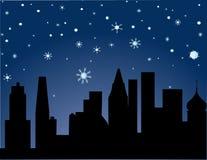 城市晚上满天星斗的冬天 库存照片