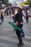 城市的居民在狂欢节期间的以纪念瓜达卢佩河贞女  库存照片
