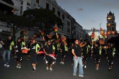 城市的居民在狂欢节期间的以纪念瓜达卢佩河贞女  免版税图库摄影