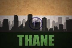城市的抽象剪影有文本大乡绅的葡萄酒印地安人旗子的 免版税库存图片