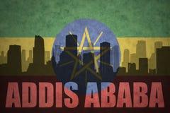 城市的抽象剪影有文本的亚的斯亚贝巴在葡萄酒埃赛俄比亚的旗子 免版税库存图片