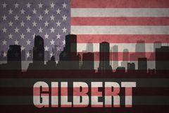 城市的抽象剪影有文本的吉尔伯特在葡萄酒美国国旗 免版税库存照片