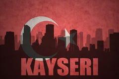 城市的抽象剪影有文本的开塞利在葡萄酒土耳其语旗子 向量例证