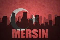 城市的抽象剪影有文本的梅尔辛在葡萄酒土耳其语旗子 向量例证