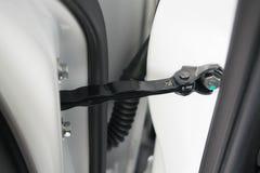 城市车,新的零件车门铰链  免版税图库摄影