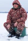 基于冬天渔的人 库存图片