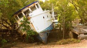 基于地面的老小船 图库摄影
