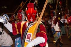 基多,厄瓜多尔- 2016年2月02日:未认出的人穿戴了参加Diablada,普遍的镇 免版税库存照片