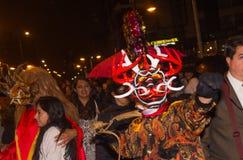 基多,厄瓜多尔- 2016年2月02日:未认出的人穿戴了参加Diablada,普遍的镇 库存照片