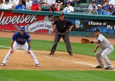 基本棒球垒手第一位赛跑者审判员 图库摄影