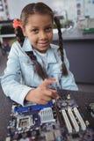 基本的女孩聚集的电路板画象  免版税库存照片
