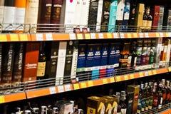 基辅,乌克兰- 2018年12月19日:瓶在架子的另外精华酒精在超级市场 免版税库存照片