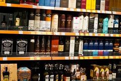 基辅,乌克兰- 2018年12月19日:瓶在架子的另外精华酒精在超级市场 图库摄影
