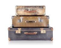 堆三个老手提箱 库存照片