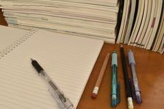 堆书和笔记本 库存图片