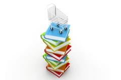 堆五颜六色的书和台车 免版税库存照片