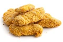堆冷冻面包被捏碎的鸡小条 免版税库存图片