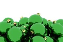 堆反对白色的绿色圣诞节球 免版税库存图片