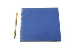 堆圆环包扎工具书或蓝色笔记本 库存图片