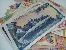 堆在另外货币的笔记 免版税库存图片
