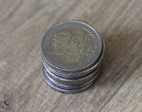 堆在木背景的两枚欧洲硬币 免版税库存照片