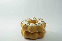 堆在白色的被分类的油炸圈饼 免版税库存照片