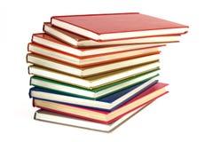 堆在白色背景的多彩多姿的书 库存照片