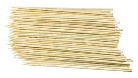 堆在白色背景的木串 免版税库存图片