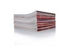堆在白色背景的杂志 免版税库存图片