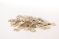 堆在白色背景的欧洲硬币 免版税库存图片
