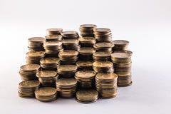 堆在白色背景的硬币 免版税图库摄影