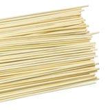 堆在白色背景的竹串 免版税库存照片