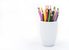 堆在白色背景的色的铅笔 复制空间 库存照片