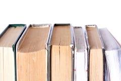 堆在白色背景的老古色古香的书 免版税图库摄影