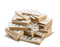 堆在白色隔绝的美元钞票 免版税库存照片