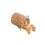 堆干坚果,能量食物,与在与裁减路线的白色背景隔绝的木柳条制品的杏仁 免版税图库摄影