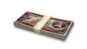 堆日本金钱,在白色的100日元货币票据 免版税库存图片