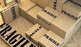 堆有易碎的信号的纸板箱 免版税库存照片