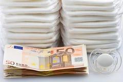 堆欧洲钞票尿布和安慰者 免版税库存照片