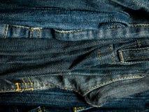 堆牛仔裤背景 图库摄影
