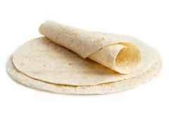 堆玉米粉薄烙饼套和一个被折叠的套 免版税库存图片