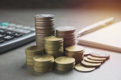 堆积与黑计算器和另一枚硬币的硬币 免版税图库摄影