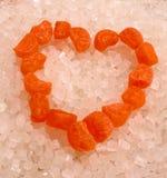 堆积在心脏形状冰糖 免版税图库摄影