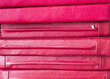 堆红色皮革坐垫 免版税库存图片