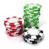 堆红色,绿色和黑赌博的芯片 库存照片