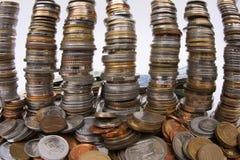 堆老硬币-贪婪 库存照片