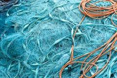 堆蓝色捕鱼网 免版税图库摄影